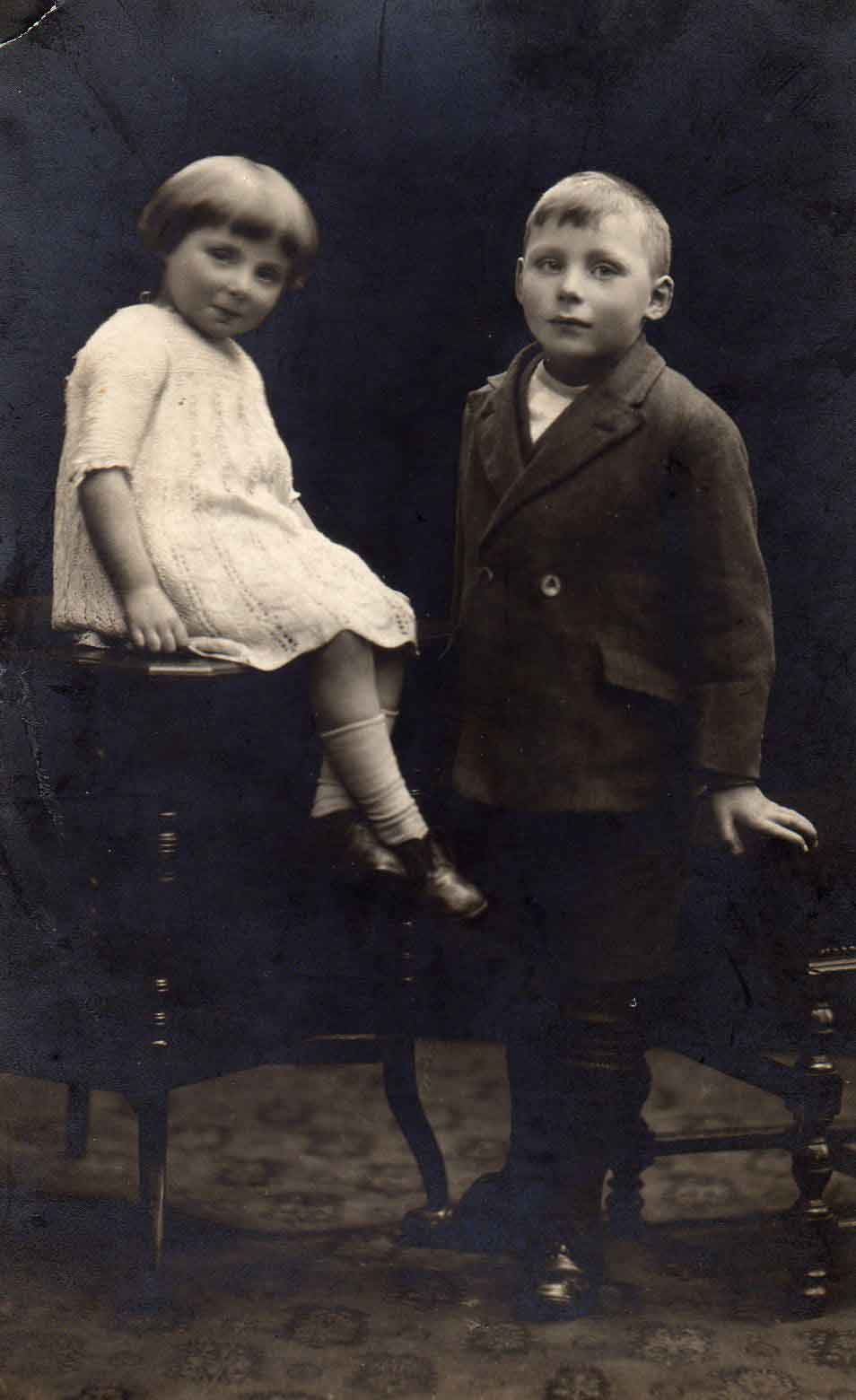 Photograph of two children posing for picture in 1920s